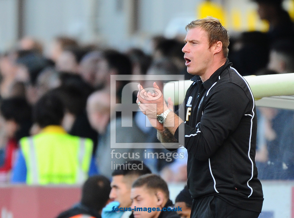 Manager of Bury David Flitcroft tries to get his team going during the Sky Bet League 2 match at the Cherry Red Records Stadium, Kingston<br /> Picture by Seb Daly/Focus Images Ltd +447738 614630<br /> 11/10/2014
