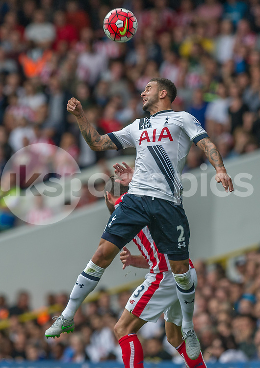 Kyle Walker of Tottenham Hotspur wins a header against  Erik Pieters of Stoke City during the Barclays Premier League match between Tottenham Hotspur and Stoke City at White Hart Lane, London, England on 15 August 2015. Photo by Vince  Mignott.