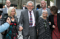 Rolf Harris Trial. Veteran Australian artist and entertainer Rolf Harris (2nd L) arrives with his wife Alwen Hughes (2nd R) and daughter Bindi (L) at Southwark Crown Court, London, United Kingdom. Friday, 9th May 2014. Picture by Daniel Leal-Olivas / i-Images