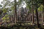 Bayon temple, seen through the surrounding trees.