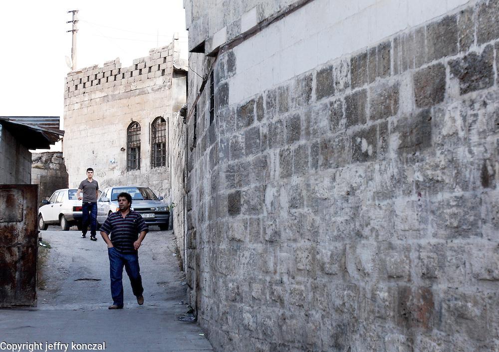 Men walk down an ally in Gaziantep, Turkey