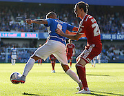 Tjaronn Chery holds of Scott Malone during the Sky Bet Championship match between Queens Park Rangers and Cardiff City at the Loftus Road Stadium, London, England on 15 August 2015. Photo by Andy Walter.