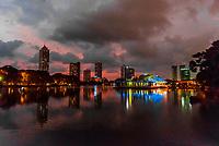 Beira Lake with skyline of Colombo at twilight behind, Sri Lanka.