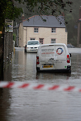 © Licensed to London News Pictures. 22/12/2012. Helston, UK. Cars surrounded by flood water in Helston caused by the River Cober bursting its banks over night after heavy rain across the South West. The Environment Agency issued a Severe flood warning for the River Cober. Photo credit : Ashley Hugo/LNP