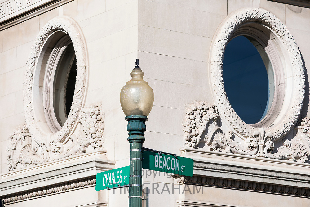 Traditional period architecture and street lamp signpost on corner of Charles Street and Beacon Street in  Boston, USA