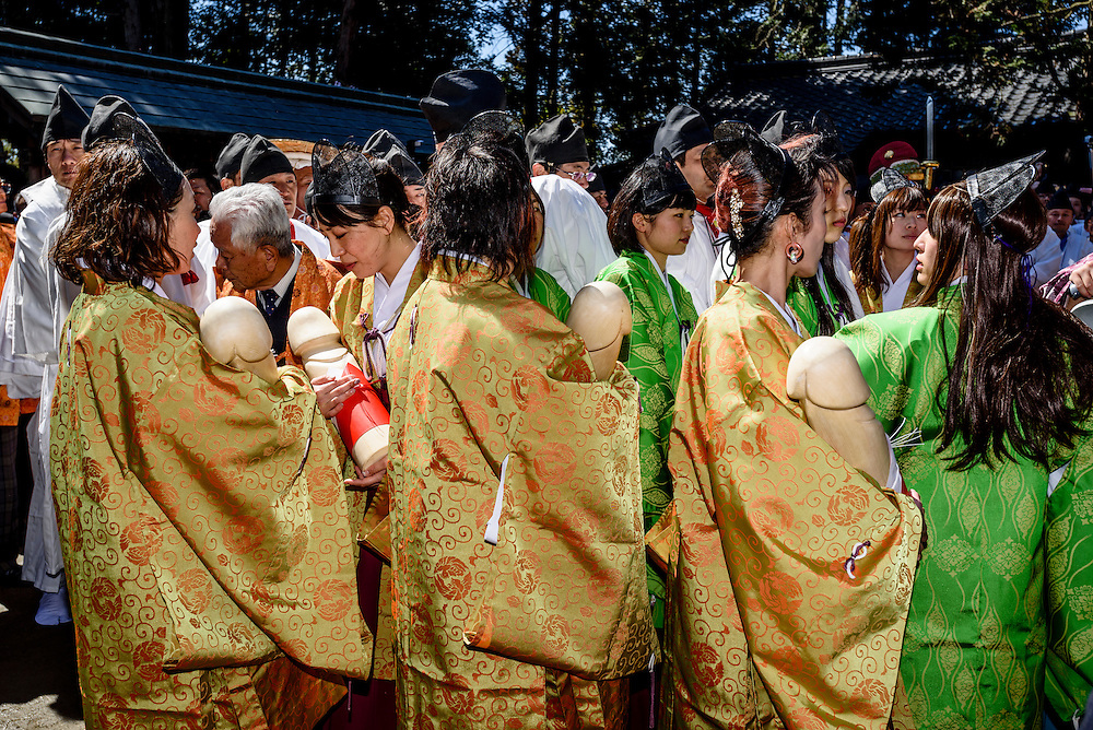 Women carry wooden phalluses during Honen-sai, a fertility festival at Tagata Shrine in Komaki, Aichi Prefecture, Japan. The traditional Shinto festival celebrates fertility and a bountiful harvest. The principal offering during the festival is a large wooden phallus. Each year a craftsman carves a new phallus from a Japanese cypress tree. It measures almost 2.4 meters (13 feet) long and weights 280kg (620 pounds).