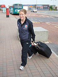 CARDIFF, WALES - Thursday, September 5, 2013: Wales' performance analyst Esther Laugharne arrives at Cardiff Airport as the squad travel to Macedonia ahead of the 2014 FIFA World Cup Brazil Qualifying Group A match. (Pic by David Rawcliffe/Propaganda)