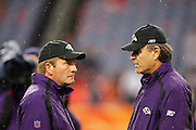 DENVER - OCTOBER 9:  Head Coach Brian Billick (right) of the Baltimore Ravens talks to offensive coordinator Jim Fassel prior to the game against the Denver Broncos at INVESCO Field at Mile High on October 9, 2006 in Denver, Colorado. The Broncos defeated the Ravens 13-3. ©Paul Anthony Spinelli *** Local Caption *** Brian Billick;Jim Fassel