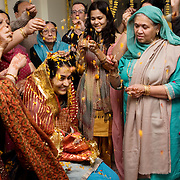 New Delhi, India, January 21, 2011. Marriage of Sumedha and Sapan. Sumedha surrounded by relatives on the wedding's morning, during a propitiatory celebration to bring good luck to her wedding.