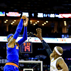 Mar 28, 2016; New Orleans, LA, USA; New York Knicks forward Carmelo Anthony (7) shoots over New Orleans Pelicans forward Dante Cunningham (44) during the first quarter of a game at the Smoothie King Center. Mandatory Credit: Derick E. Hingle-USA TODAY Sports