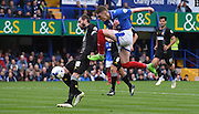 Nicky Hunt makes the sucessful block against Caolan Lavery during the Sky Bet League 2 match between Portsmouth and Mansfield Town at Fratton Park, Portsmouth, England on 24 October 2015. Photo by Michael Hulf.
