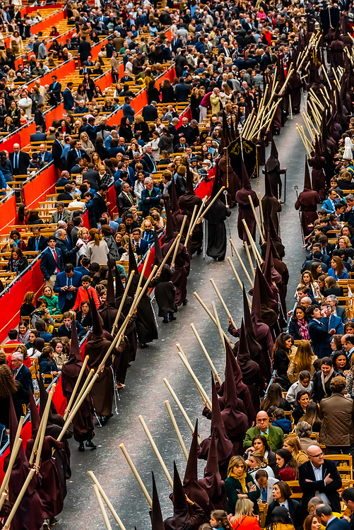 Hooded Penitents (Nazarenos) in the procession of the Brotherhood (Hermandad) El Buen Fin, Holy Week (Semana Santa), Seville, Andalusia, Spain.