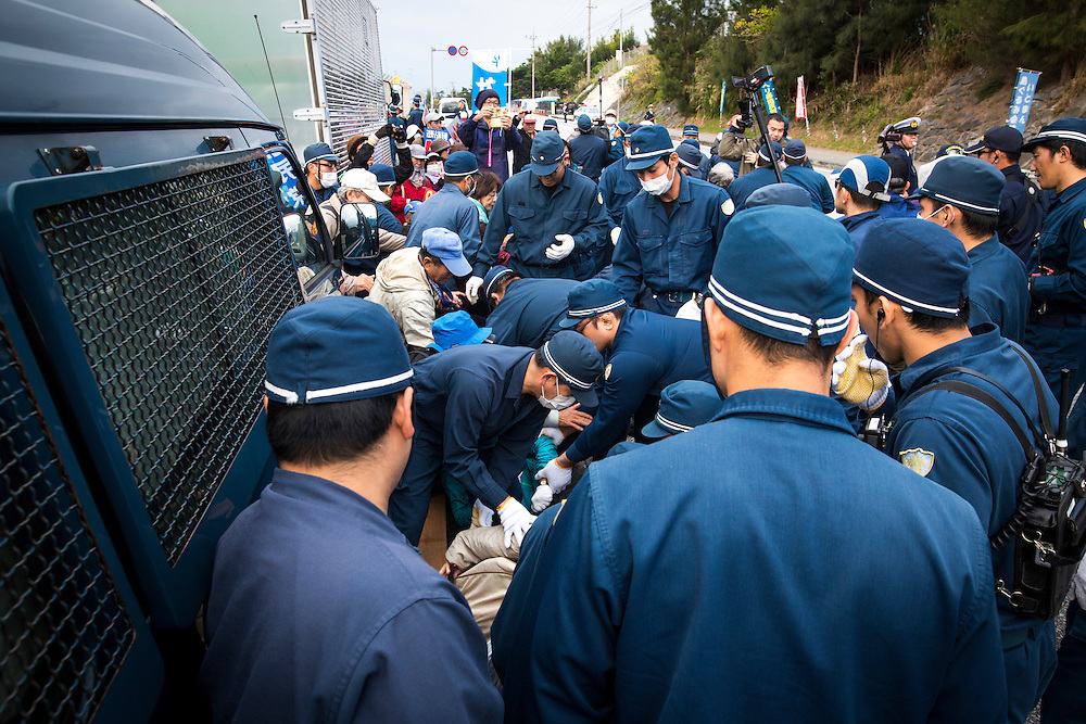 OKINAWA, JAPAN - JANUARY 21 : Police remove anti-U.S. Base protesters during a rally outside of the gate of Camp Schwab to protest against the construction of the new U.S Marine Airbase in Henoko, Nago, Okinawa, Japan on January 21, 2017. (Photo by Richard Atrero de Guzman/ANADOLU Agency)