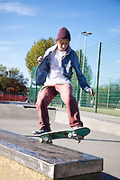 Low angle view of young man skateboarding
