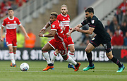Adama Traoré of Middlesbrough  goes past Aston Villa's Mile Jedinak during the EFL Sky Bet Championship match between Middlesbrough and Aston Villa at the Riverside Stadium, Middlesbrough, England on 12 May 2018. Picture by Paul Thompson.