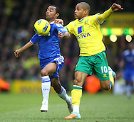 Picture by Paul Chesterton/Focus Images Ltd.  07904 640267.21/01/12.Simeon Jackson of Norwich and Ashley Cole of Chelsea in action during the Barclays Premier League match at Carrow Road Stadium, Norwich.