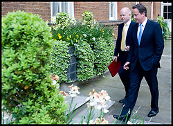 British Prime Minister David Cameron with First Secretary of State, Secretary of State for Foreign and Commonwealth Affairs William Hague in the garden of Downing Street after the first Cabinet meeting of the new Government,  May 13, 2010. Photo By Andrew Parsons / i-Images