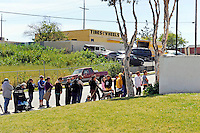 Food recipients in line to pick up basics from a La Paz Park distribution point, managed by Celebration Worship and supplied by the Food Bank of Monterey County.
