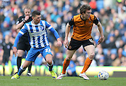 Kevin McDonald and Danny Holla, Brighton midfielder during the Sky Bet Championship match between Brighton and Hove Albion and Wolverhampton Wanderers at the American Express Community Stadium, Brighton and Hove, England on 14 March 2015.