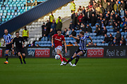Sheffield Wednesday captain Tom Lees clears the ball from the attacking Callum O'Dowda of Bristol City FC during the EFL Sky Bet Championship match between Sheffield Wednesday and Bristol City at Hillsborough, Sheffield, England on 22 December 2019.