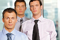 Three businessmen at office, portrait