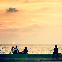 Where: Havana, Cuba.<br /> Sunset. Interesting the 3 -2- 1 of the locals. And the two spheres in the image. Did you find the second?