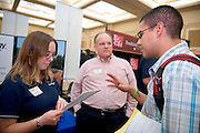 19082Fall Career Fair in Baker Center 10/08/08..First Energy ..Angela Durnan and Hal Kruger talk to Esteban Hincapie