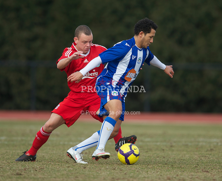WIGAN, ENGLAND - Wednesday, March 17, 2010: Liverpool Reserves' Jay Spearing and Wigan Athletic Reserves' Rachid Bouaouzan during the Lancashire Senior Cup Semi-Final at the Robin Park Sports Arena. (Photo by David Rawcliffe/Propaganda)