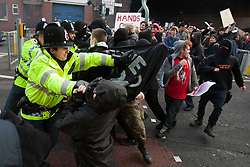 © under license to London News Pictures. 24/11/2010: Students in Manchester protest against cutbacks and the coalition government's proposed rise in tuition fees. Some protesters dressed in black broke through police lines and away from the protest route.