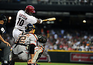 June 14 2011; Phoenix, AZ, USA; Arizona Diamondbacks batter Justin Upton (10) singles to left during the fourth inning against the San Francisco Giants at Chase Field. Mandatory Credit: Jennifer Stewart-US PRESSWIRE.