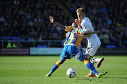 Sam Kelly of Port Vale FC finds his path blocked by Junior Brown of Shrewsbury Town during the Sky Bet League 1 match between Shrewsbury Town and Port Vale at Greenhous Meadow, Shrewsbury, England on 25 March 2016. Photo by Mike Sheridan.