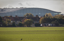 "© Licensed to London News Pictures. 27/10/2016. London, UK. Heathrow's Terminal 5 dominates the horizon above houses south of the village of Harmondsworth. The government has announced that a third runway will be built at the United Kingdom's busiest airport. The Cabinet are divided - with Foreign Secretary Boris Johnson saying that the project is ""undeliverable"". Conservative MP for Richmond Zac Goldsmith has resigned. Photo credit: Peter Macdiarmid/LNP"