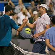 August 21, 2014, New Haven, CT:<br /> Andy Roddick and James Blake shake hands at net after playing each other during the Men's Legends Event on day seven of the 2014 Connecticut Open at the Yale University Tennis Center in New Haven, Connecticut Thursday, August 21, 2014.<br /> (Photo by Billie Weiss/Connecticut Open)