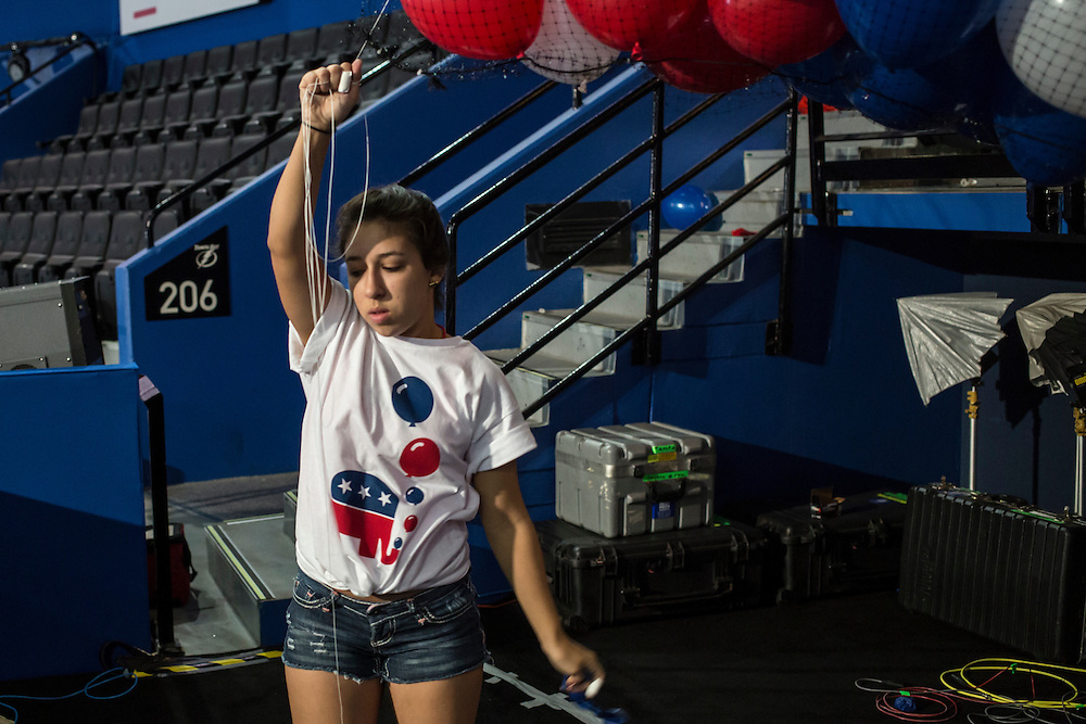 A student from Tampa's Gaither High School helps to inflate balloons in preparation for the balloon drop at the Republican National Convention on Friday, August 24, 2012 in Tampa, FL.