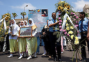 "Egyptian mourners carry flowers and mementos of Marwa Sherbini, 31, during her funeral in the Egyptian port city of Alexandria July 6, 2009. Sherbini was stabbed to death inside a German courtroom by a 28 year old attacker, Axel W., who had been previously convicted of insulting her religion. Newspapers in Egypt have expressed outrage over the attack and have dubbed her the ""martyr of the hijab"" and ""headscarf martyr."""