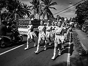 07 AUGUST 2017 - MANGGIS, BALI, INDONESIA: Students from schools in eastern Bali participate in an Indonesian Independence Day march in Manggis, an ocean side community in eastern Bali. Indonesian Independence Day, the country's national holiday, is celebrated on August 17. It was on that date in 1945 that Sukarno signed Indonesia's proclamation of independence from the Netherlands. It was the beginning of a four year war for independence. The Dutch didn't officially grant Indonesia independence until December, 1949. The day is celebrated with parades and enthusiastic displays of patriotism throughout the country.    PHOTO BY JACK KURTZ