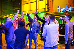 © Licensed to London News Pictures . 11/09/2016 . Manchester , UK . A group of men chant Manchester United songs on Withy Grove , despite the team's earlier loss against local rival Manchester City . Revellers out in Manchester City Centre . Photo credit : Joel Goodman/LNP