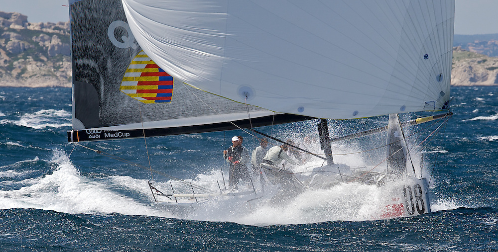 Audi TP52 Powered by Q8 sailing at speed during Race 4 of the AUDI Medcup in Marseilles