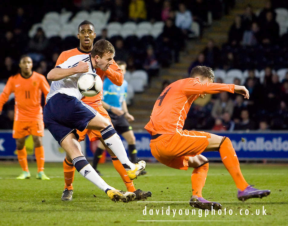 Scotland's Jordan Rhodes and Holland's Bram Nuytinck - Scotland v Holland - UEFA U21 European Championship qualifier at St Mirren Park..© David Young - .5 Foundry Place - .Monifieth - .Angus - .DD5 4BB - .Tel: 07765 252616 - .email: davidyoungphoto@gmail.com.web: www.davidyoungphoto.co.uk