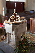 Simple stone baptismal font early early 13th century church at Urchfont, Wiltshire, England, UK