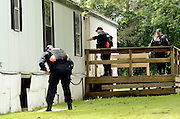 Members of the Correction Emergency Response Team from Elmira, NY, search residences off of Route 275 in the town of Friendship, NY, Sunday, June 21, 2015, in search of the escaped convicts that was reported in the area. <br /> (Heather Ainsworth for The New York Times)