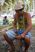 Coconut husking, Fakarava, Tuamotu Islands, French Polynesia, (Editorial use only)<br />