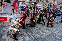 Edinburgh Scotland 7th August 2016 :: Performers from Fringe shows entertain in the High Street to promote their shows.<br /> <br /> Pictured:  Young Japanese dancers performs in the High Street.<br /> <br /> (c) Andrew Wilson | Edinburgh Elite media