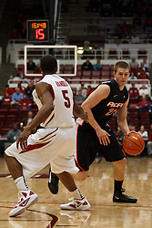 Nov 28, 2011; Stanford CA, USA;  Pacific Tigers forward Adam Eakles (21) is defended by Stanford Cardinal guard Chasson Randle (5) during the first half at Maples Pavilion. Stanford defeated Pacific 79-37. Mandatory Credit: Jason O. Watson-US PRESSWIRE