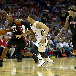 Oct 23, 2013; New Orleans, LA, USA; Miami Heat shooting guard Ray Allen (34) drives past New Orleans Pelicans shooting guard Austin Rivers (25) during the first half of a preseason game at New Orleans Arena. Mandatory Credit: Derick E. Hingle-USA TODAY Sports