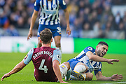 Daniel Drinkwater (Aston Villa) & Neal Maupay (Brighton) collide during a tackle and end up on the ground during the Premier League match between Brighton and Hove Albion and Aston Villa at the American Express Community Stadium, Brighton and Hove, England on 18 January 2020.