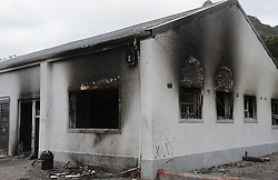 Cape Town - 180813 - The Hout Bay fishing community are distraught and tensions are running high after an alleged poacher was shot at see while being apprehended by the authorities In pic is a torched inspectors office on the harbour -  Photographer - Tracey Adams - ANA African News Agency