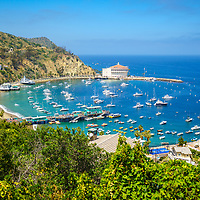Catalina Island Avalon Harbor high resolution photo from above. Includes the Catalina Casino theater, Avalon Pier, Holly Hill House, and Avalon city buildings. Beautiful Santa Catalina Island is a popular travel destination off the Southern California coast. Copyright ⓒ 2017 Paul Velgos with All Rights Reserved.