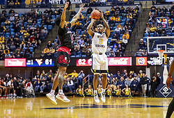 Dec 22, 2018; Morgantown, WV, USA; West Virginia Mountaineers guard Brandon Knapper (2) shoots a three pointer during the second half against the Jacksonville State Gamecocks at WVU Coliseum. Mandatory Credit: Ben Queen-USA TODAY Sports