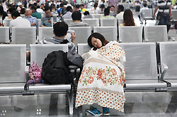 File photo taken on July 2, 2011 shows a passenger sleeping at the Nanjing Railway Station in Nanjing, capital of east China s Jiangsu Province. March 21 marks the World Sleep Day, which is an annual event intended to be a celebration of sleep and a call to action on important issues related to sleep. Photo by Imago / i-Images...UK ONLY.